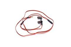 在白色隔绝的红色耳机 库存图片