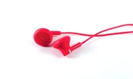 在白色隔绝的红色耳机 库存照片