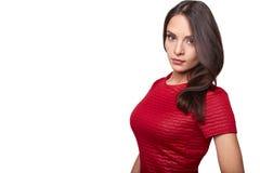 在白色隔绝的红色衬衣的俏丽的女孩 免版税库存照片