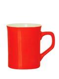 在白色隔绝的红色陶瓷茶杯 库存图片