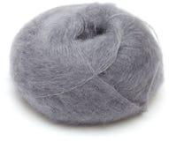 在白色隔绝的编织的羊毛球 图库摄影