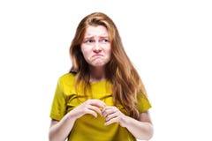 在白色隔绝的美丽的年轻和失望的女孩 免版税库存图片
