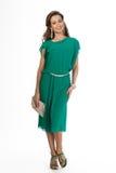 在白色隔绝的美好的女商人时装模特儿。绿色 库存照片