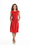 在白色隔绝的美好的忙妇女时装模特儿。红色博士 库存图片