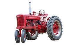 在白色隔绝的老红色工作拖拉机 免版税库存照片