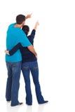 年轻夫妇指向 免版税库存图片