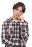 英俊少年认为 免版税库存照片