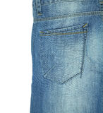 在白色隔绝的蓝色牛仔裤的后面口袋 免版税库存图片