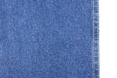 在白色隔绝的蓝色牛仔裤织品纹理 免版税库存图片