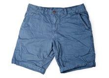在白色隔绝的蓝色男性短裤 免版税库存照片