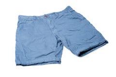 在白色隔绝的蓝色男性短裤 免版税库存图片