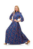 在白色隔绝的蓝色花服的少妇 库存图片