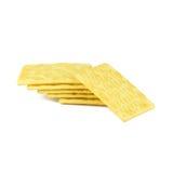 在白色隔绝的薄脆饼干黄色 免版税库存照片