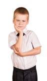 在白色隔绝的被使昏迷的逗人喜爱的男小学生 库存照片