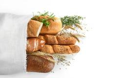 在白色隔绝的被分类的面包 库存照片