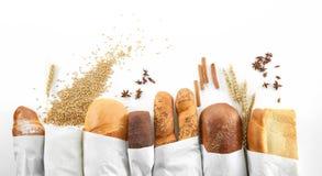 在白色隔绝的被分类的面包 免版税库存图片