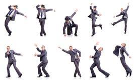 在白色隔绝的跳舞商人 免版税库存图片