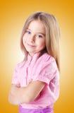 在白色隔绝的逗人喜爱的小女孩 免版税库存图片