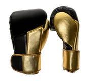 在白色隔绝的金黄和黑皮革皮革拳击手套 免版税图库摄影
