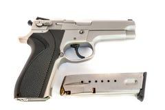 在白色隔绝的银色枪 免版税库存照片