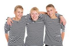 在白色隔绝的镶边衬衣的微笑的男孩 库存照片
