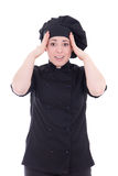 在白色隔绝的黑制服的激动的厨师妇女 免版税图库摄影