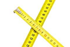 在白色隔绝的2卷金属测量的磁带 免版税图库摄影