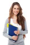 在白色隔绝的年轻愉快的学生 免版税库存照片