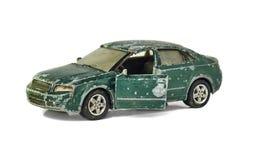 在白色隔绝的破旧的玩具汽车 免版税图库摄影