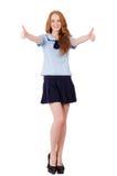 在白色隔绝的年轻淘气学生女性 免版税库存照片