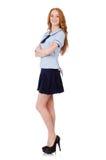 在白色隔绝的年轻淘气学生女性 免版税图库摄影