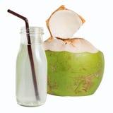 在白色隔绝的玻璃瓶的椰子水 免版税库存照片