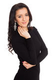 在白色隔绝的黑礼服的美丽的女孩 免版税库存照片