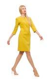 在白色隔绝的黄色礼服的俏丽的女孩 免版税库存图片