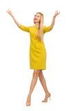 在白色隔绝的黄色礼服的俏丽的女孩 免版税库存照片