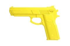 在白色隔绝的黄色训练枪 图库摄影