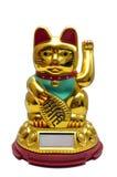 在白色隔绝的Maneki Neko幸运的金黄猫 库存图片
