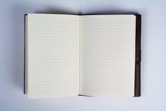 在白色顶视图克洛打开的一定的皮革学报书 免版税库存照片