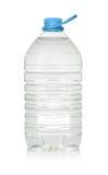 在白色饮用水隔绝的塑料瓶 免版税库存照片