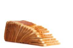 在白色高关键背景的切的白面包 库存照片