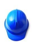 在白色,安全帽的蓝色安全帽隔绝了裁减路线 免版税库存照片
