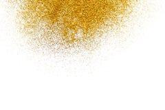 在白色,抽象背景的金黄闪烁沙子纹理 免版税图库摄影