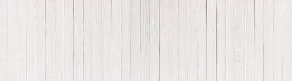 在白色,木桌或墙壁中绘的匾作为背景 库存照片