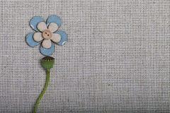 在白色织品背景的抽象花 图库摄影