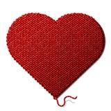 在白色b隔绝的被编织的织品的心脏标志 免版税库存照片