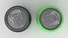 在白色bac的两个小黑和绿色铝汽水罐大模型 免版税库存照片