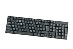 在白色backgrond的黑键盘键计算机 免版税库存照片