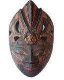 在白色backgroud的蜡染布木面具纪念品 免版税库存照片