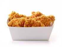 在白色cardbord箱子的油煎的面包鸡内圆角 免版税库存图片