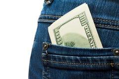 在的美元钞票蓝色牛仔裤 库存照片